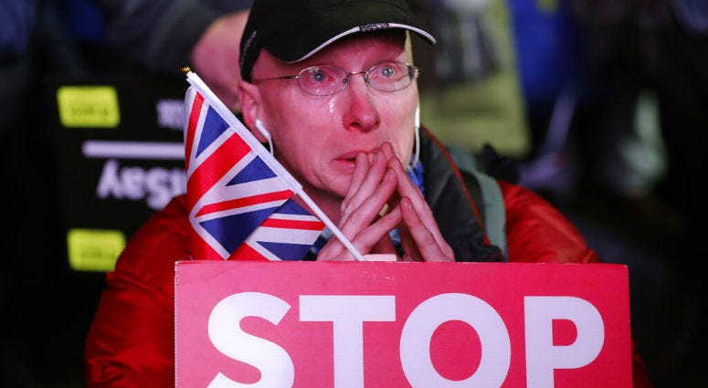 An anti-Brexit demonstrator cries as he gathers in Parliament square in London, Tuesday, Jan. 15, 2019.