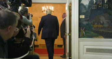 President Donald Trump departs after speaking about the partial government shutdown, immigration and border security in the Diplomatic Reception Room of the White House, in Washington, Saturday, Jan. 19, 2019.