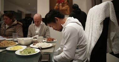 FILE - In this Jan. 14, 2019, file photo, boxer Manny Pacquiao prays before breakfast at his home following his morning run in Los Angeles.