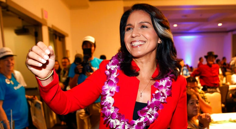 In this Nov. 6, 2018, file photo, Rep. Tulsi Gabbard, D-Hawaii, greets supporters in Honolulu.