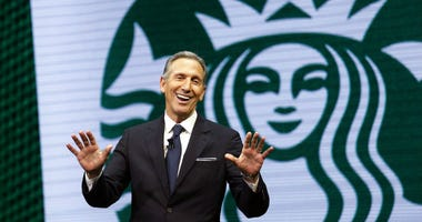 FILE - In this March 22, 2017 file photo, Starbucks CEO Howard Schultz speaks at the Starbucks annual shareholders meeting in Seattle.