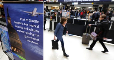 A sign near a TSA security checkpoint states the Port of Seattle's support for federal government workers, Friday, Jan. 25, 2019, in Seattle.