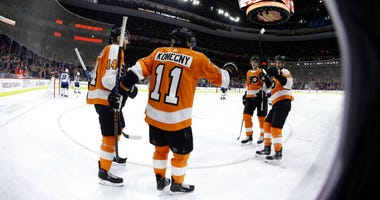 Philadelphia Flyers' Travis Konecny (11) celebrates with Sean Couturier (14) , Andrew MacDonald (47) and Travis Sanheim (6) after scoring a goal during the second period of an NHL hockey game against the Winnipeg Jets, Monday, Jan. 28, 2019, in Philadelph