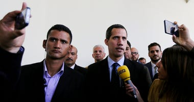 Opposition National Assembly President Juan Guaido, who declared himself interim president of Venezuela, speaks with the media upon his arrival to National Assembly in Caracas, Venezuela, Tuesday, Jan. 29, 2019.