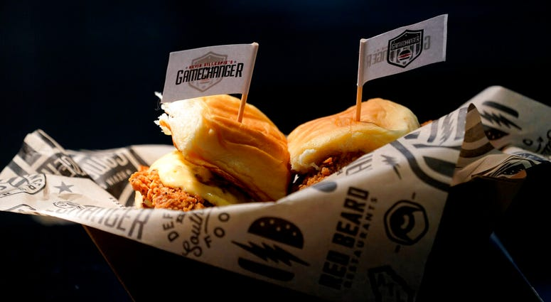 A sandwich is prepared for the media to taste during a tour of Mercedes-Benz Stadium for the NFL Super Bowl 53 football game Tuesday, Jan. 29, 2019, in Atlanta.