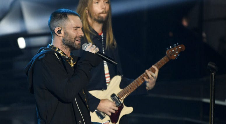 FILE - In this Sunday, March 11, 2018 file photo, Adam Levine, left, and James Valentine of Maroon 5 perform during the 2018 iHeartRadio Music Awards at The Forum in Inglewood, Calif.