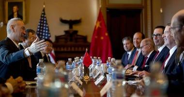 US Trade Representative Robert Lighthizer, right, accompanied by Trump Administration officials, meets with Chinese Vice Premier Liu He, left, and other Chinese officials as they begin US-China Trade Talks in the Diplomatic Room of the Eisenhower Executiv
