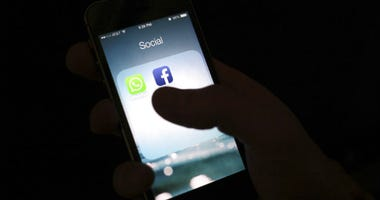 FILE - This Feb. 19, 2014, file photo shows the Facebook app icon on an iPhone in New York. Apple says it has banned a Facebook-made app that paid users, including teenagers, to extensively track their data.