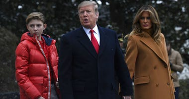 In this Feb. 1, 2019, photo, President Donald Trump, center, first lady Melania Trump, right, and their son Barron Trump, left, walk out of the White House and head to Marine One on the South Lawn of White House in Washington.