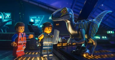 """This image released by Warner Bros. Pictures shows the characters Emmet, left, and Rex Dangervest, center, both voiced by Chris Pratt, in a scene from """"The Lego Movie 2: The Second Part."""""""