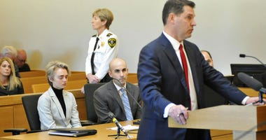 Michelle Carter, 22, second left, appears in Taunton District Court in Taunton, Mass. Monday, February 11, 2019 for a hearing on her prison sentence as lawyer Joe Cataldo speaks at the podium.