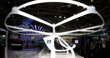 FILE -In this Monday, June 11, 2018 file photo, the multi-rotor electric aircraft Volocopter 2x, displayed at the electronic fair Cebit in Hannover, Germany.