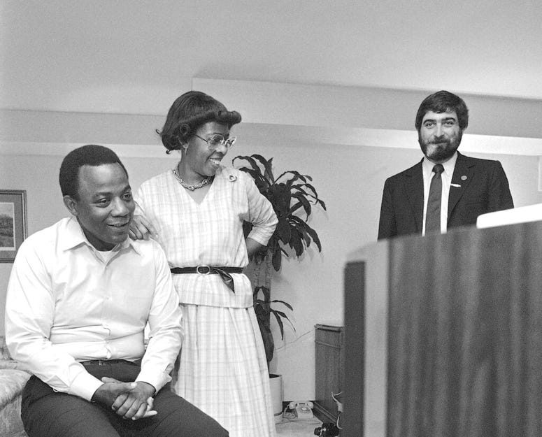 In this May 17, 1983 file photo, W. Wilson Goode and his wife Velma smile as they react to the news on television of a heavy black voter turn out in west Philadelphia in the Democratic primary election at the Philadelphia Centre Hotel.