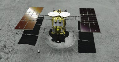 FILE - This computer graphic image provided by the Japan Aerospace Exploration Agency (JAXA) shows the Japanese unmanned spacecraft Hayabusa2 approaching on the asteroid Ryugu.