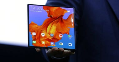 Huawei CEO Richard Yu displays the new Huawei Mate X foldable 5G smartphone at the Mobile World Congress, in Barcelona, Spain, Sunday, Feb. 24, 2019.