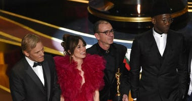 "Viggo Mortensen, from left, Linda Cardellini, Dimiter Marinov and Mahershala Ali accept the award for best picture for ""Green Book"" at the Oscars on Sunday, Feb. 24, 2019, at the Dolby Theatre in Los Angeles."