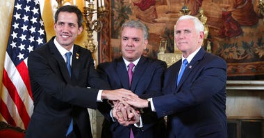 Venezuela's self-proclaimed interim president Juan Guaido, Colombia's President Ivan Duque and Vice President Mike Pence, pose for a photo after a meeting of the Lima Group concerning Venezuela at the Foreign Ministry in Bogota, Colombia, Monday, Feb. 25,