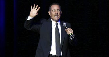 FILE - In this Nov. 1, 2016 file photo, Jerry Seinfeld performs at Stand Up For Heroes, at The Theater in New York's Madison Square Garden.