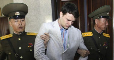 FILE - In this March 16, 2016, file photo, American student Otto Warmbier, center, is escorted at the Supreme Court in Pyongyang, North Korea.