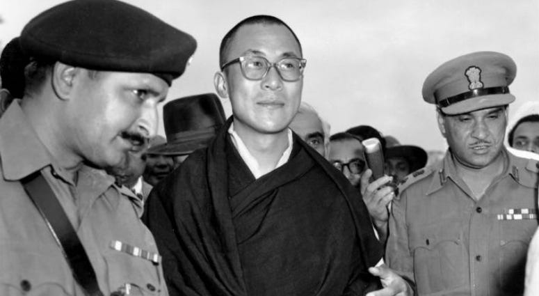 FILE - In this April 18, 1959, file photo, Tibetan spiritual leader the Dalai Lama, center, arrives at Tezpur, Assam in India.