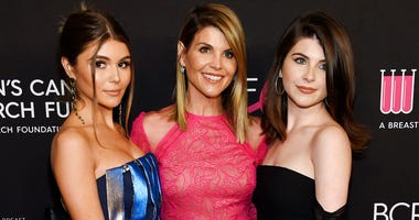 Actress Lori Loughlin, center, poses with daughters Olivia Jade Giannulli, left, and Isabella Rose Giannulli.