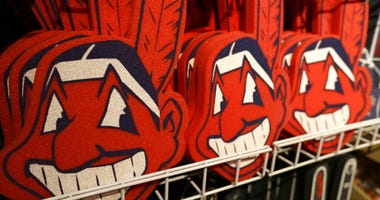Foam images of the MLB baseball Cleveland Indians' mascot Chief Wahoo are displayed for sale at the Indians' team shop in Cleveland.