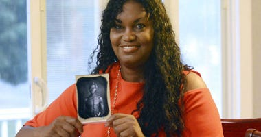 Tamara Lanier holds an 1850 photograph of Renty, a South Carolina slave who Lanier said is her family's patriarch, at her home in Norwich, Conn.