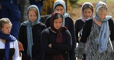 Mourners leave the cemetery after the burial service of the body of a victim of the Friday March 15 mosque shootings at the Memorial Park Cemetery in Christchurch, New Zealand.