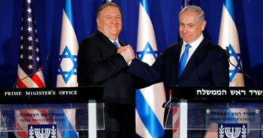 U.S. Secretary of State Mike Pompeo, left, shakes hands with Israeli Prime Minister Benjamin Netanyahu.