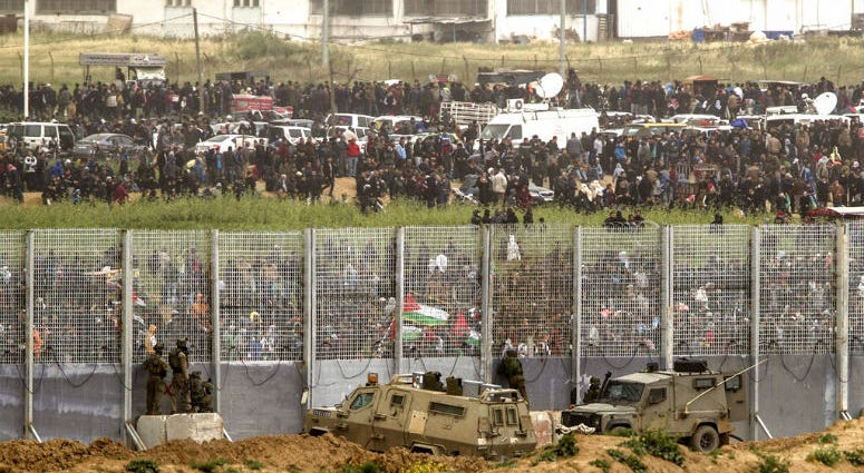 Tens of thousands of Palestinians have rallied at points near the Israeli border to mark the first anniversary of weekly protests in the Gaza Strip.