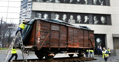 "The train car joins hundreds of artifacts from Auschwitz at the museum for an exhibit entitled ""Auschwitz. Not long ago. Not far away,"" that opens to the public on May 8."