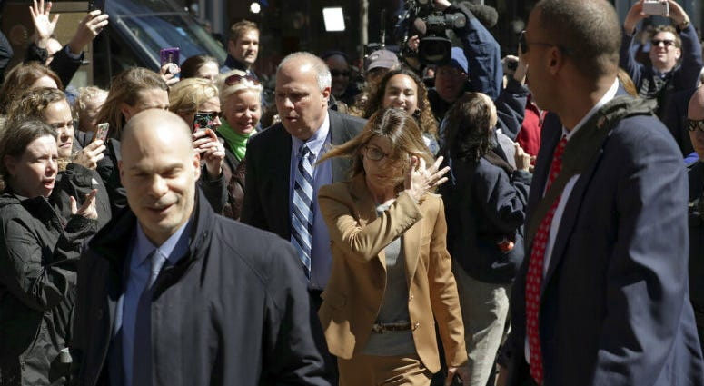 People photograph actress Lori Loughlin as she arrives at federal court in Boston on Wednesday, April 3, 2019, to face charges in a nationwide college admissions bribery scandal.