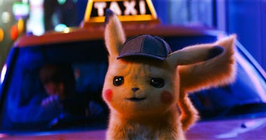 """This image released by Warner Bros. Pictures shows the character Detective Pikachu, voiced by Ryan Reynolds, in a scene from """"Pokemon Detective Pikachu."""""""