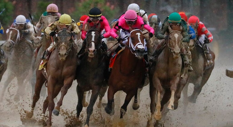 Luis Saez riding Maximum Security, second from right, goes around turn four with Flavien Prat riding Country House, left, Tyler Gaffalione riding War of Will and John Velazquez riding Code of Honor, right, during the 145th running of the Kentucky Derby ho