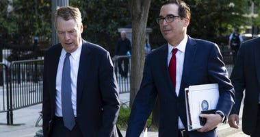 United States Trade Representative Robert Lighthizer, left, and Treasury Secretary Steven Mnuchin walk on Pennsylvania Avenue back to the White House after meeting with Chinese Vice Premier Liu He for trade talks Thursday, May 9, 2019, in Washington.