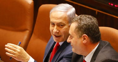 Israeli Prime Minister Benjamin Netanyahu faced a deadline at midnight Wednesday to form a new governing coalition as he tried to stave off a crisis that could trigger an unprecedented second election this year or even force the longtime leader to step do