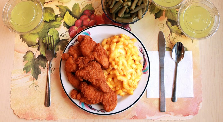 "This undated photo provided by the National Institutes of Health in June 2019 shows an ""ultra-processed"" lunch including brand name macaroni and cheese, chicken tenders, canned green beans and diet lemonade."