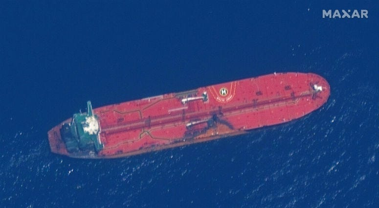 New satellite photos released Monday show two oil tankers apparently attacked in the Gulf of Oman last week.