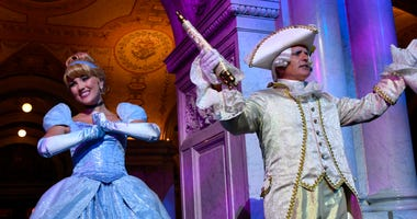 "Costumed Cinderella and Majordomo appear before guests at an event marking the inclusion of Disney's ""Cinderella"" into the National Film Registry on its 70th anniversary, Thursday night, June 20, 2019 at the Library of Congress in Washington."