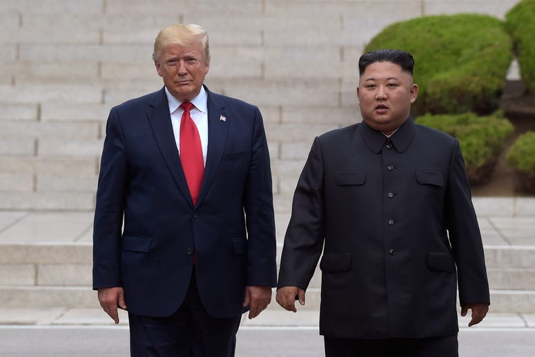 President Donald Trump, left, meets with North Korean leader Kim Jong Un at the North Korean side of the border at the village of Panmunjom in Demilitarized Zone, Sunday, June 30, 2019.