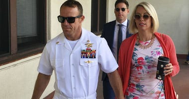 The trial continued Monday in the court-martial of the decorated Navy SEAL, who is accused of stabbing to death a wounded teenage Islamic State prisoner and wounding two civilians in Iraq in 2017.