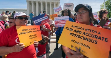 In this April 23, 2019 file photo, immigration activists rally outside the Supreme Court as the justices hear arguments over the Trump administration's plan to ask about citizenship on the 2020 census, in Washington.