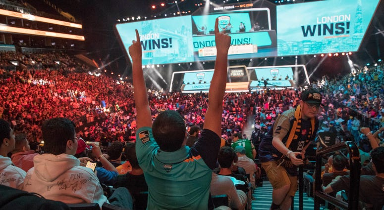 In this July 28, 2018, file photo, London Spitfire fan Rick Ybarra, of Plainfield, Ind., reacts after London won the second game against the Philadelphia Fusion during the Overwatch League Grand Finals competition at Barclays Center in New York.