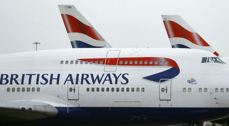 FILE - This Jan. 10, 2017 file photo shows British Airways planes parked at Heathrow Airport in London. On Saturday, July 20, 2019, British Airways said it is canceling flights to Cairo for a week for unspecified security reasons.