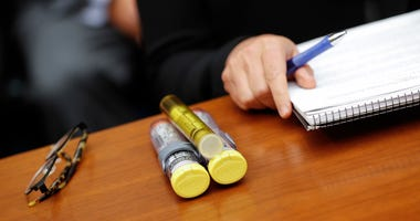 In this Sept. 21, 2016, file photo EpiPens that Mylan CEO Heather Bresch bought with her are seen on Capitol Hill in Washington as she testifies before the House Oversight Committee hearing on EpiPen price increases.