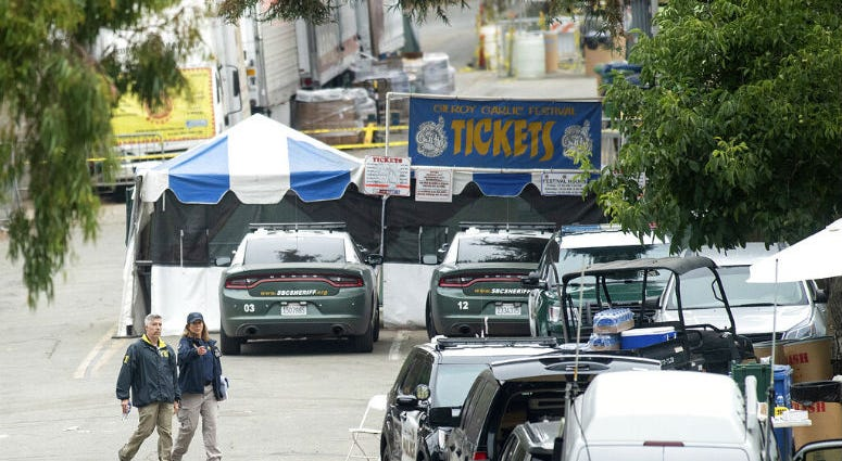 FBI personnel pass a ticket booth at the Gilroy Garlic Festival Monday, July 29, 2019 in Calif., the morning after a gunman killed at least three people, including a 6-year-old boy, and wounding about 15 others.