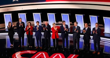 From left: Marianne Williamson, Tim Ryan, Amy Klobuchar, Pete Buttigieg, Bernie Sanders, Elizabeth Warren, Beto O'Rourke, John Hickenlooper, John Delaney and Steve Bullock take the stage for a Democratic primary debate in Detroit.