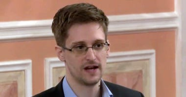 In this Oct. 11, 2013 file image made from video and released by WikiLeaks, former National Security Agency systems analyst Edward Snowden speaks in Moscow. Snowden has written a memoir.