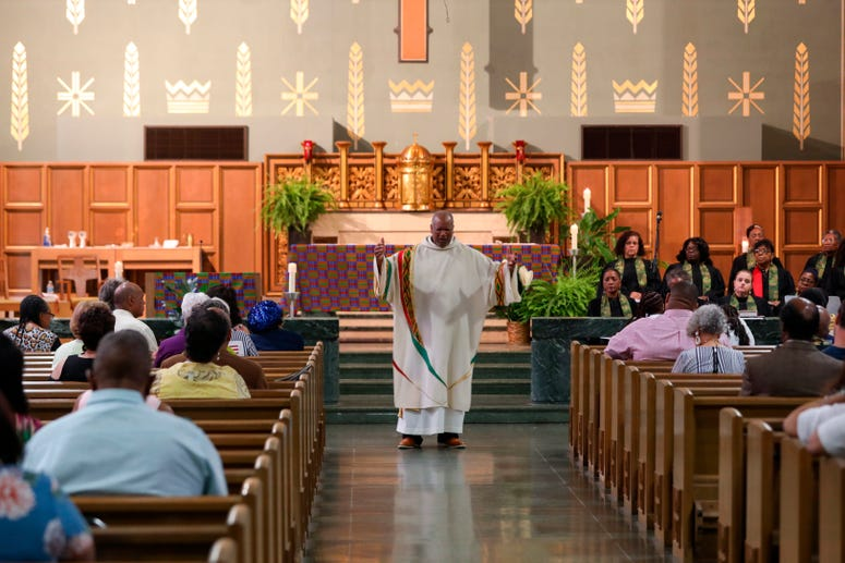 In this May 27, 2019, Royce Winters, a former police officer and the director of African-American Ministries for the Catholic Archdiocese of Cincinnati, preaches the homily during Mass at the Church of the Resurrection in Cincinnati.