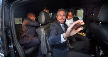 A$AP Rocky, background right, leaves the district court in Stockholm by car, after the third day of his trial, Friday, Aug. 2, 2019.